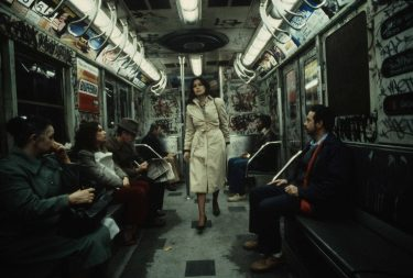 Christopher Morris in 1981: A woman walks through a heavily graffitied subway car, 1981.