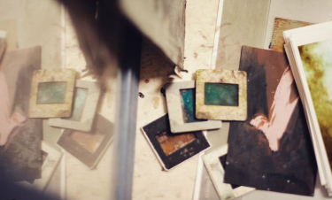 Negatives of old photographs stained by the passage of time.